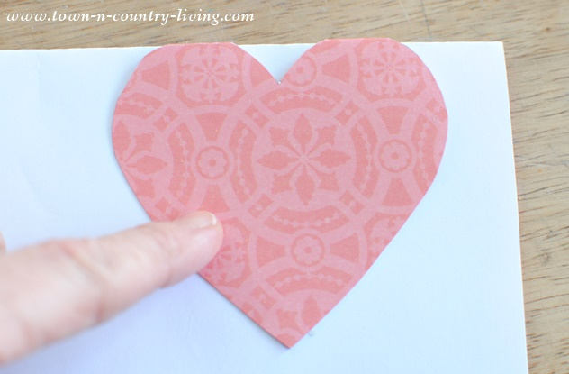 Trace paper hearts to create a Valentine's banner