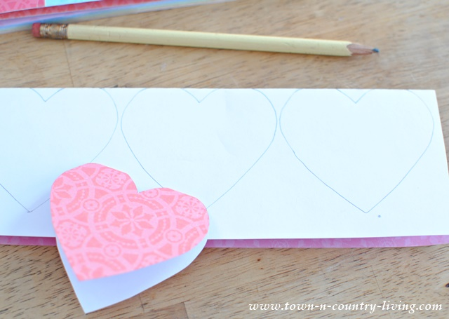 Trace hearts onto folded scrapbook paper