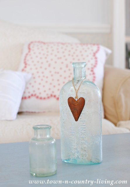 Vintage Aqua Bottle with Red Metal Heart