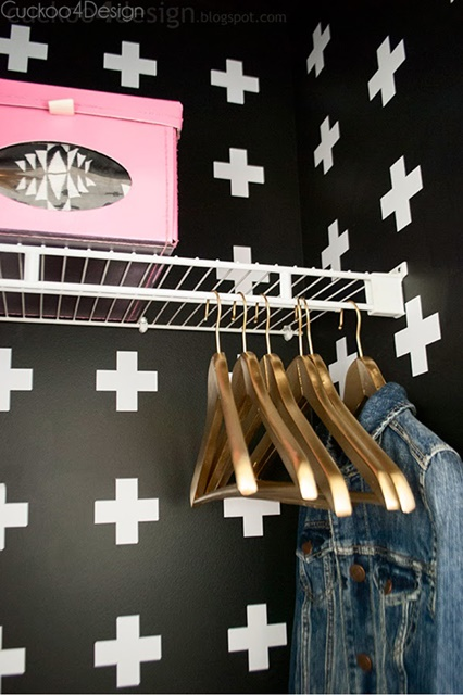 Hallway closet painted in fun black and white cross pattern