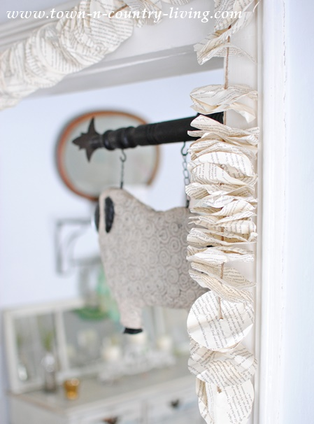 Crumpled book pages cut into circles make a pretty garland for the doorway.