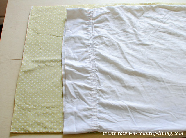 How to make your own pillow cases. Cut your fabric to size using an existing pillow case as your guide.