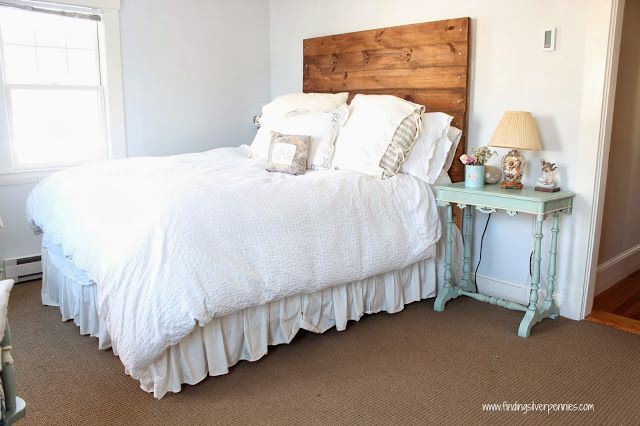 Master Bedroom with wood headboard and white bedding