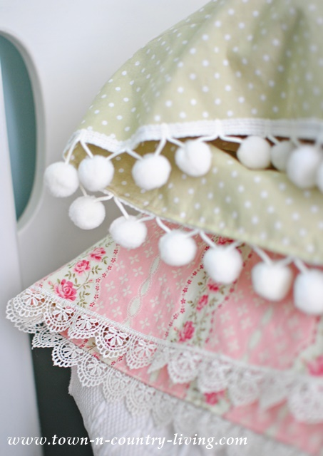 Pom pom trim, or ball fringe, looks pretty on DIY vintage style pillow cases