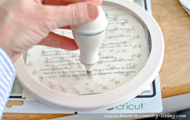 How to use a circle cutter to make circles from book pages.