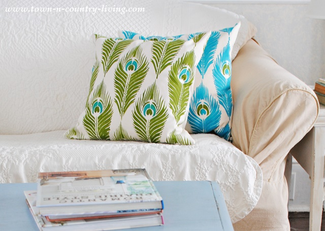 Stenciled pillows in a peacock feather pattern