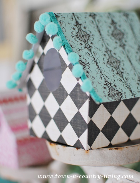 DIY Paper Birdhouse made with scrapbook paper and mini pom pom trim. See how easy it is to make!