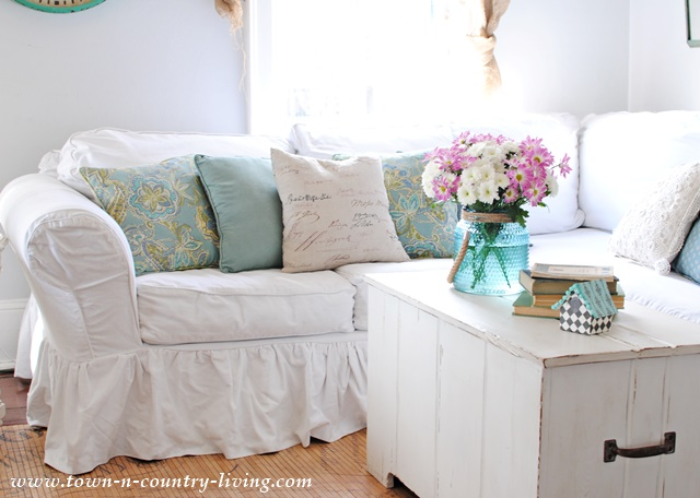 An easy way to decorate for the seasons is to simply swap out the pillows on your sofa and chairs.
