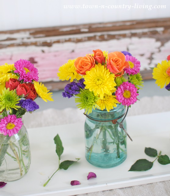 Colorful store bought flowers look charming in mason jars
