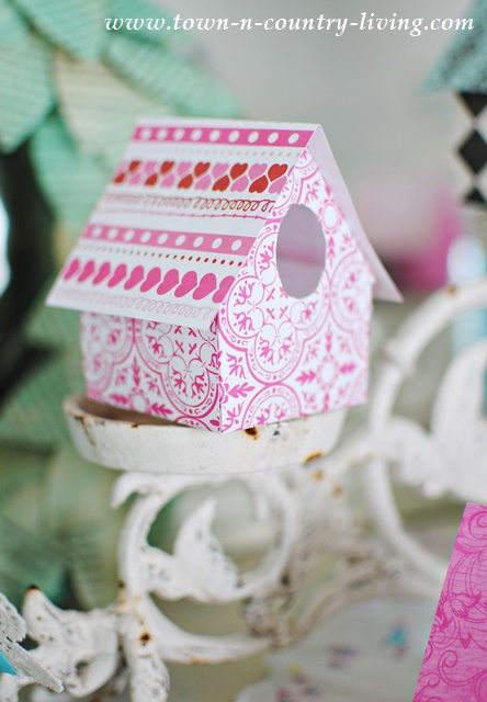 Paper Birdhouse Tutorial. Simply cut, fold, and glue scrapbook paper into these charming little birdhouses.