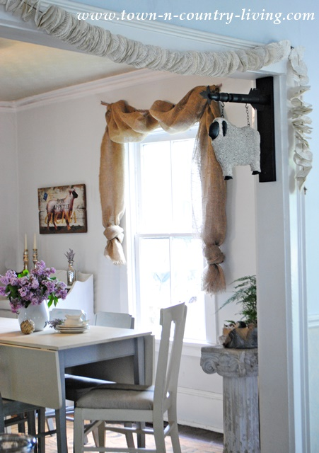No-Sew Landscape Burlap Curtain Swags in Farmhouse Dining Room. See how easy it is to make them!