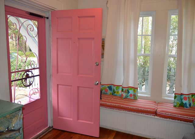 Pink Front Door in a Cottage Entry Way