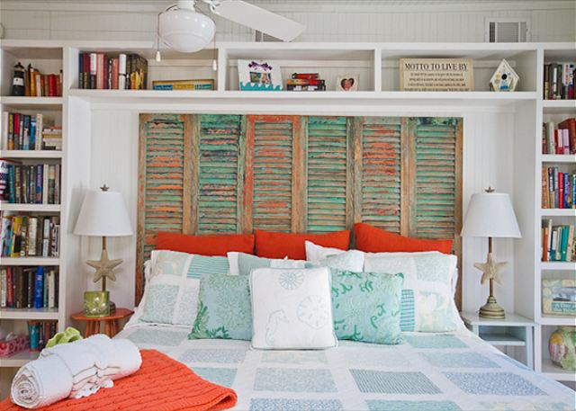 Painted and Peeling Shutters Make a Unique Headboard