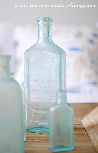 Collection of Vintage Aqua Bottles in Farmhouse Family Room