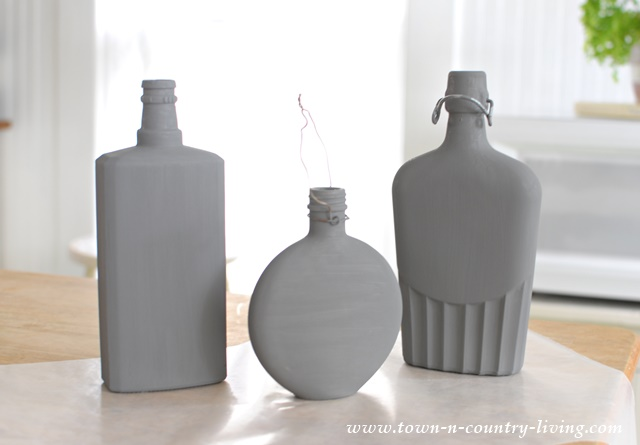 Decorate unused glass bottles with chalk paint. See the results after they're distressed!