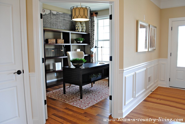 Industrial chic model home town country living for Model home flooring