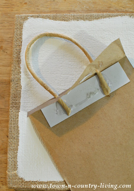 Use decorative paper bags to create inexpensive wall art.
