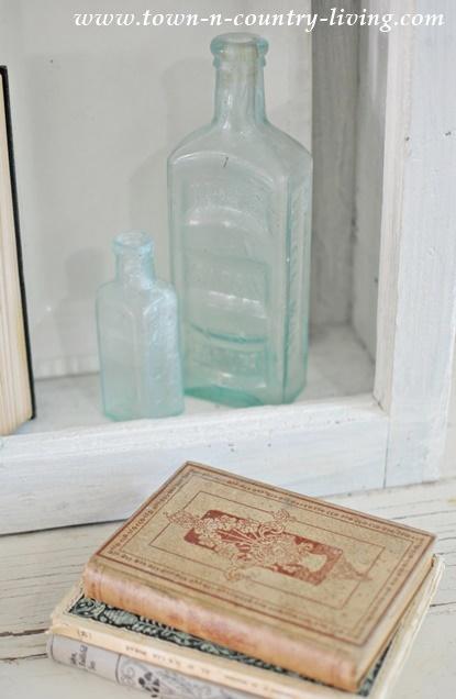 Vintage Vignette with Aqua Bottles