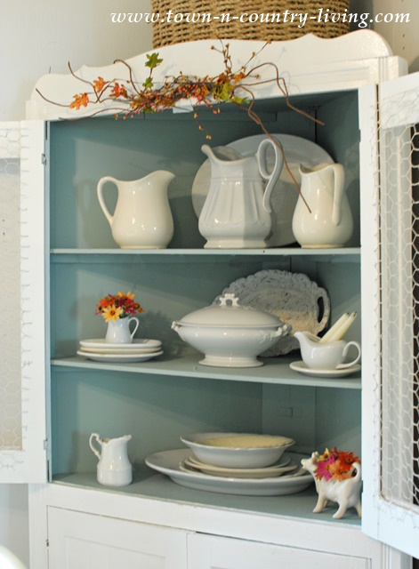 Dining Hutch with White Ironstone in Farmhouse Dining Room